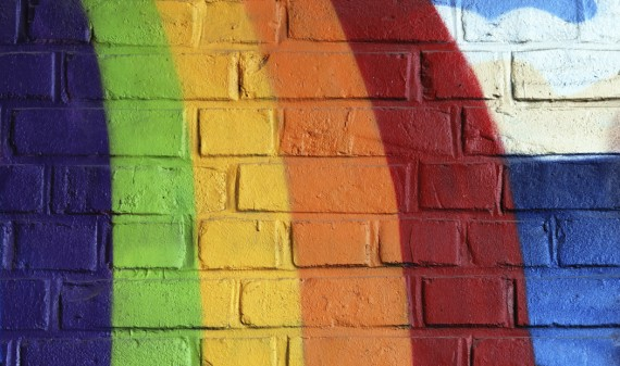 Rainbow painted on brick wall